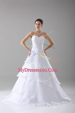 Dazzling A-line Sleeveless White Wedding Gown Brush Train Lace Up